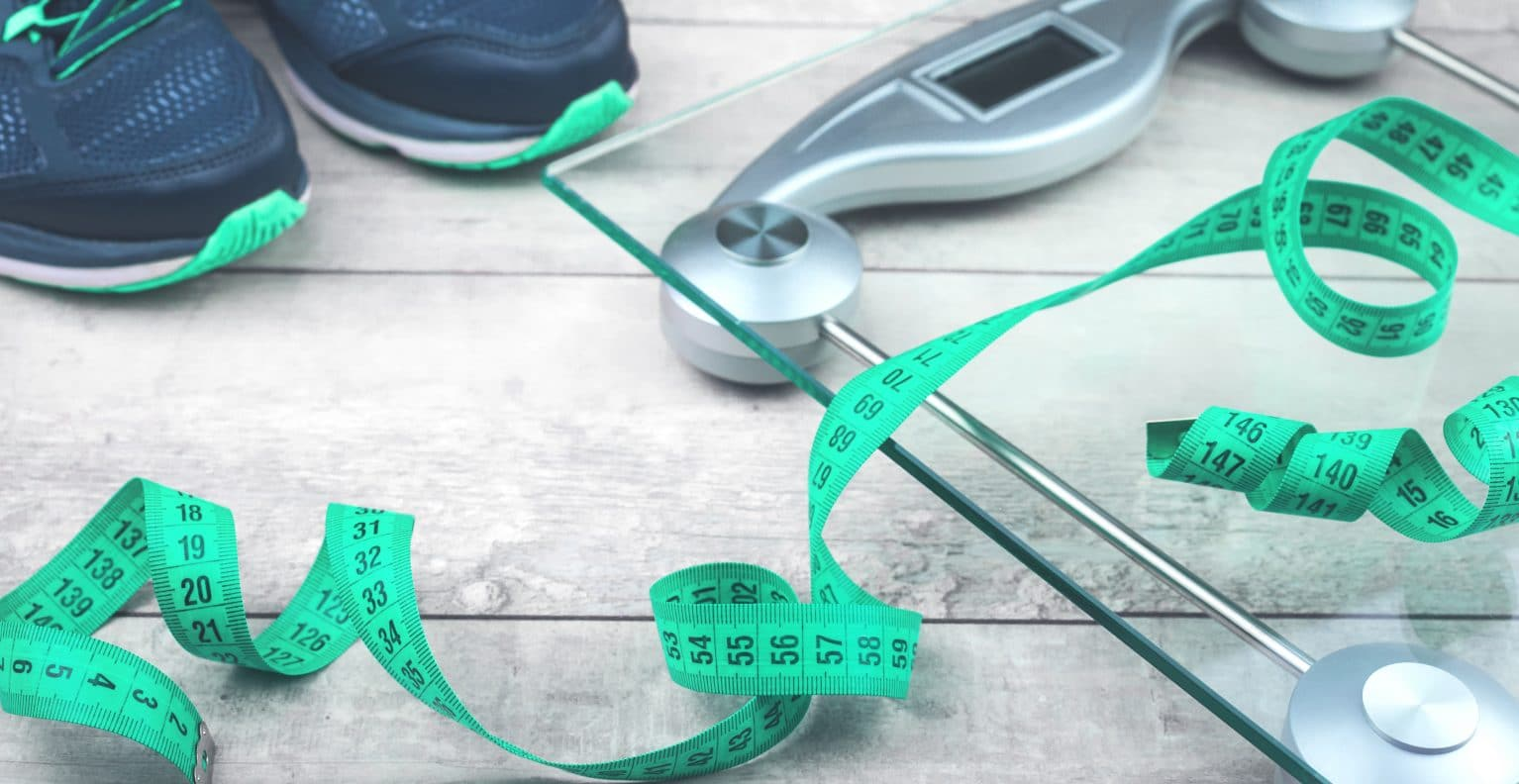obesity management scale and measuring tape